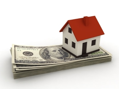 Home on Stack of Bills For Real Estate - David Mize
